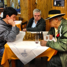 My best friend played 2 games of chess with a regular at the restaurant while the owner watched...