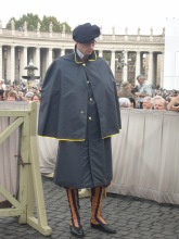Then I was glad for the light rain as we got to see their rain coats come out! They were delievered to the Swiss Guard who could not leave their post